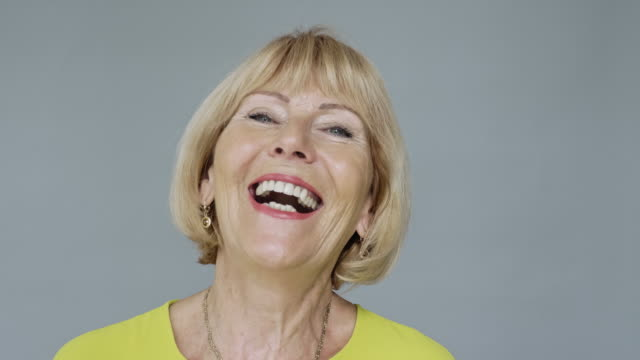 portrait of caucasian woman in late 60s  laughing at camera - form of communication stock videos & royalty-free footage