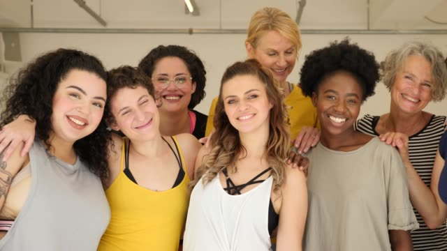 portrait of cheerful females in fitness class - body positive stock videos and b-roll footage
