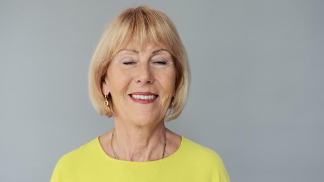 portrait of cheerful senior caucasian woman with bobbed hair - capelli biondi video stock e b–roll