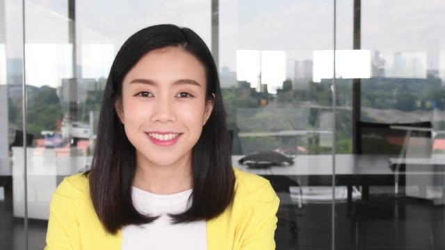 Portrait of cheerful young Chinese businesswoman