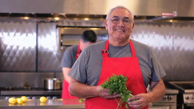 MS Portrait of Chef in Commercial Kitchen / Richmond, Virginia, USA