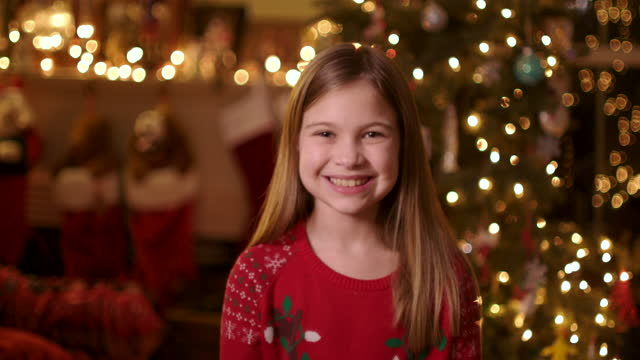 portrait of child and christmas tree - straight hair stock videos & royalty-free footage