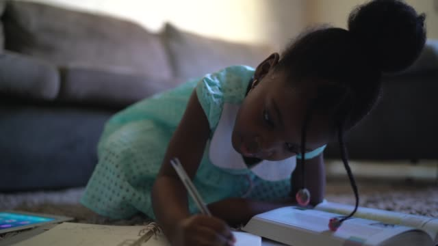 portrait of child doing homework at home - afro stock videos & royalty-free footage