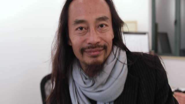 portrait of chinese businessman in the office - curiosity stock videos & royalty-free footage