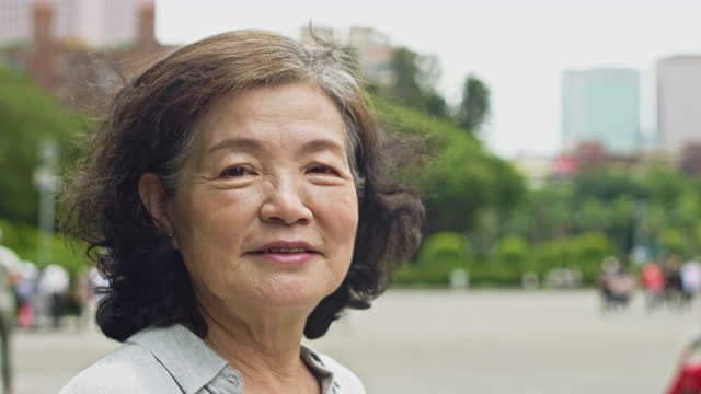 "portrait of chinese senior woman outdoors on spring day - xavierarnau or ""xavier arnau serrat"" stock videos & royalty-free footage"