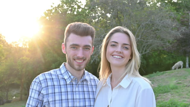 portrait of compatible young couple in rural environment - blouse stock videos & royalty-free footage