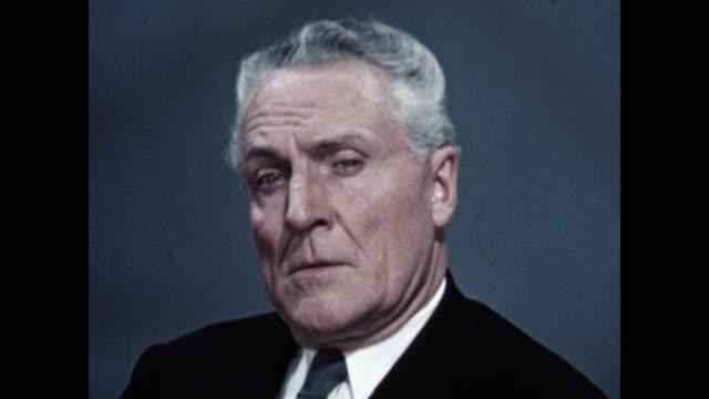 portrait of concerned senior man talking indoors - grått hår bildbanksvideor och videomaterial från bakom kulisserna