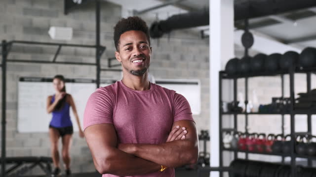 portrait of confident black sportsman standing in gym - males stock videos & royalty-free footage