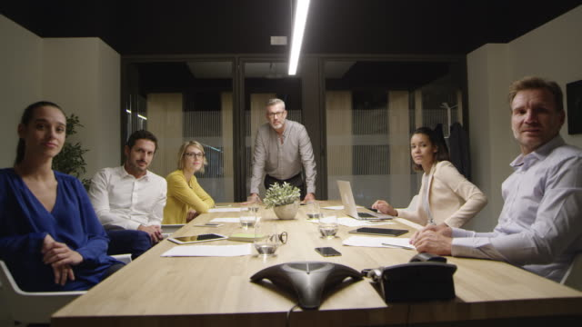 portrait of confident business people in boardroom - sala conferenze video stock e b–roll