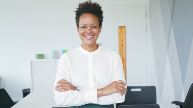 portrait of confident businesswoman in her office. - short hair stock videos & royalty-free footage