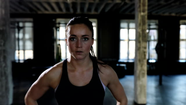 Portrait of confident female athlete in gym