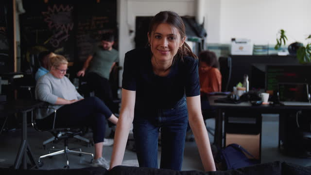 vídeos y material grabado en eventos de stock de portrait of confident female computer programmer smiling while colleagues discussing in background at office - escandinavia