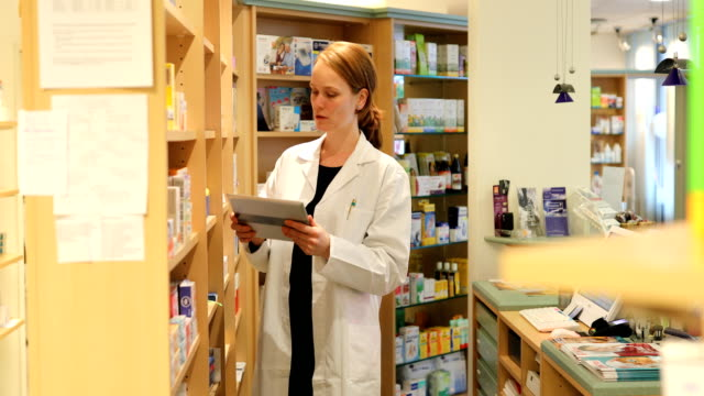 Portrait Of Confident Female Pharmacist In Store
