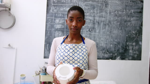 portrait of confident female pottery owner - preparation stock videos & royalty-free footage