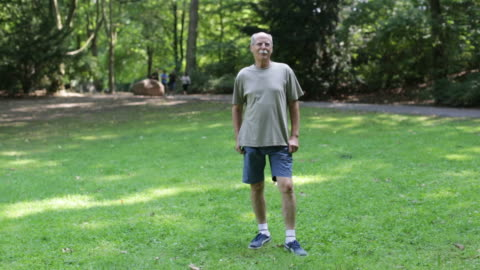 portrait of confident fit senior man standing in park - full length stock videos & royalty-free footage
