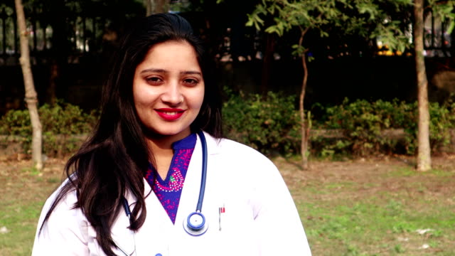 portrait of confident indian female healthcare professional doctor - video portrait stock videos & royalty-free footage