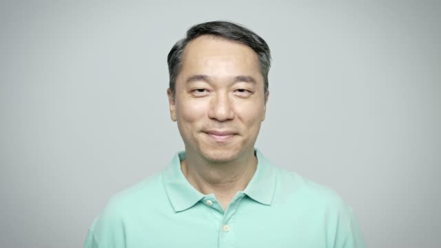 portrait of confident mature businessman smiling - polo shirt stock videos & royalty-free footage