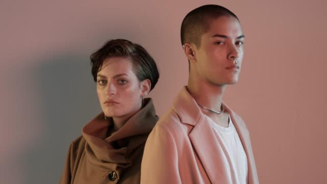 vidéos et rushes de portrait of confident multi-ethnic fashion models - veste et blouson
