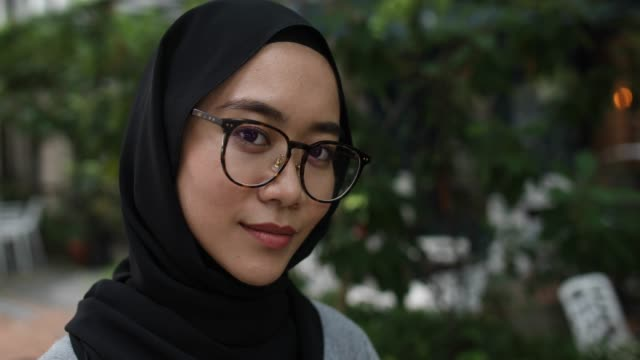 portrait of confident muslim woman - malaysian ethnicity stock videos & royalty-free footage