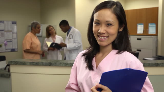 portrait of confident nurse - scrubs stock videos & royalty-free footage
