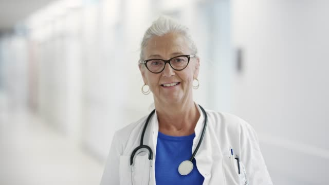portrait of confident senior doctor at hospital - clinic stock videos & royalty-free footage