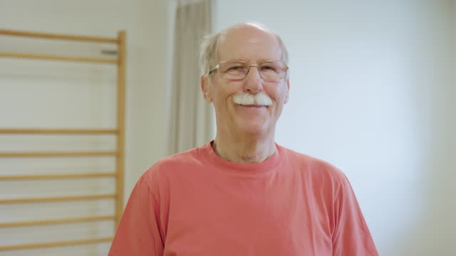 portrait of confident senior man in health club - rehabilitation center stock videos & royalty-free footage