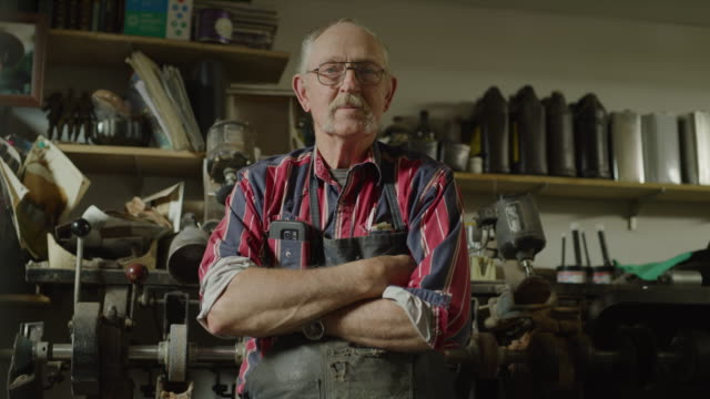 portrait of confident shoemaker standing in workshop / spring city, utah, united states - oberkörperaufnahme stock-videos und b-roll-filmmaterial
