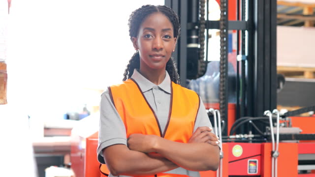 portrait of confident worker with arms crossed - mid adult women stock videos & royalty-free footage