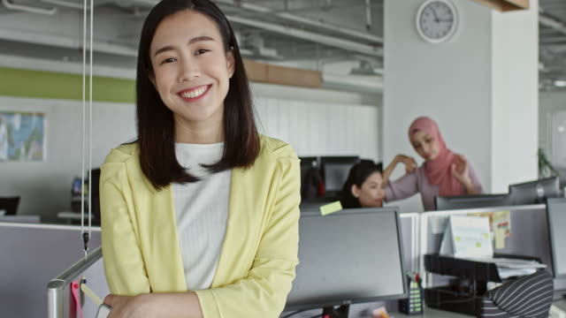 Portrait of confident young Chinese businesswoman in office