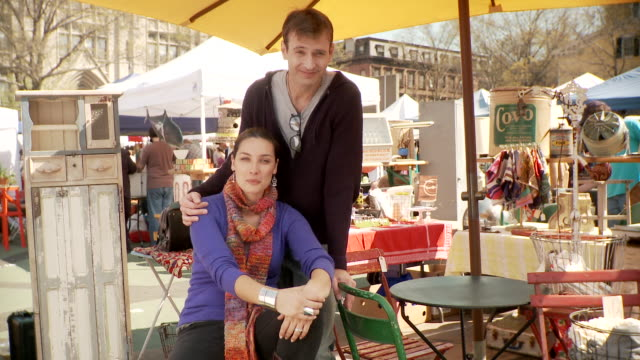 ms portrait of couple at flea market stall, new york city, new york, usa - flea market stock videos & royalty-free footage
