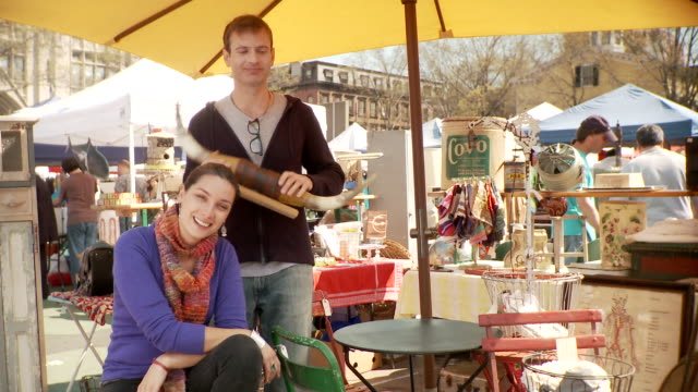 MS PAN Portrait of couple at flea market stall, New York City, New York, USA
