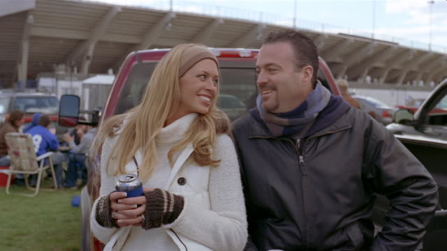 Portrait of couple at tailgate party