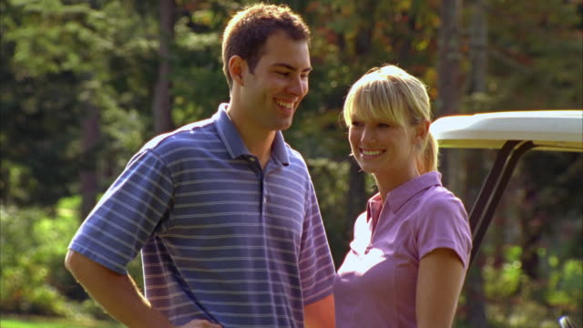 cu, portrait of couple hugging standing by golf cart, seco, maine, usa - golf glove stock videos and b-roll footage