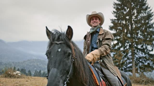 slo mo portrait of cowboy stroking horse's neck - cowboy stock videos & royalty-free footage