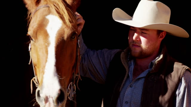 Portrait of cowboy with horse Dude Ranch Canada