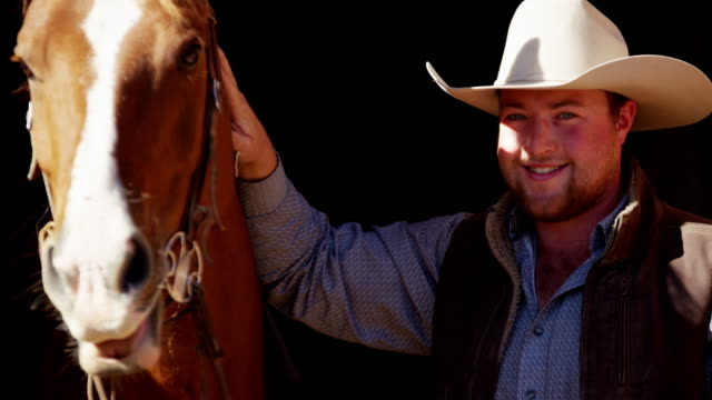 Portrait of cowboy with horse Dude Ranch USA