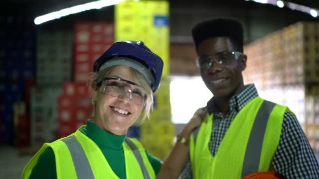 portrait of coworkers in a warehouse - reflective clothing stock videos & royalty-free footage
