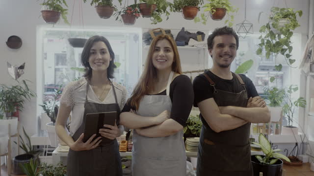 portrait of co-workers with manager of a small plant shop - argentinian culture stock videos & royalty-free footage