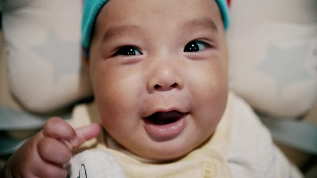 portrait of cute baby boy(2-5 months) looking at camera and smiling - baby stock videos & royalty-free footage
