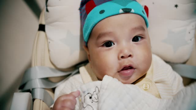 portrait of cute baby boy(2-5 months) looking at camera and smiling - south east asian ethnicity stock videos & royalty-free footage