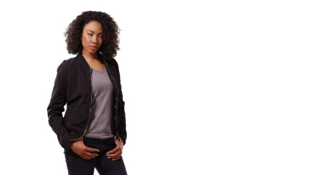 portrait of cute black female looking at camera with cool confidence in studio - model object stock videos & royalty-free footage