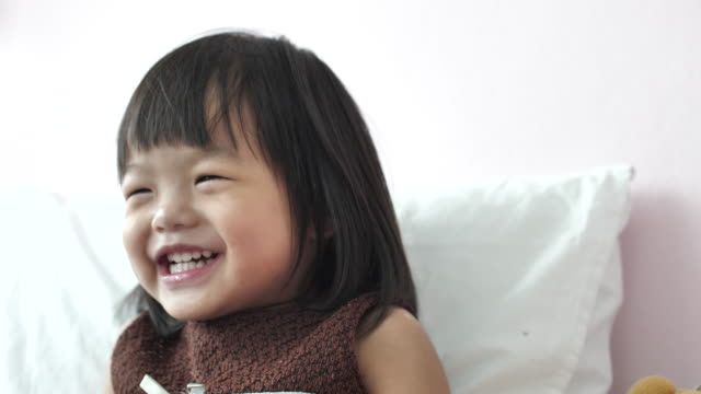 slo mo  portrait of cute girl laughing and smiling happily - social issues stock videos & royalty-free footage