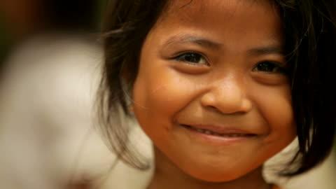 portrait of cute girl smiling happily - le bildbanksvideor och videomaterial från bakom kulisserna
