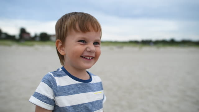 portrait of cute little boy on the beach in summer - white caucasian stock videos & royalty-free footage