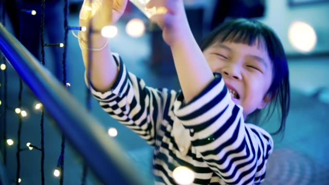 portrait of cute little girl(4-5 years) excitement in christmas festival - 4 5 years stock videos & royalty-free footage