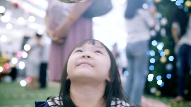 portrait of cute little girl(4-5 years) excitement in christmas festival - 4 5 years stock videos and b-roll footage