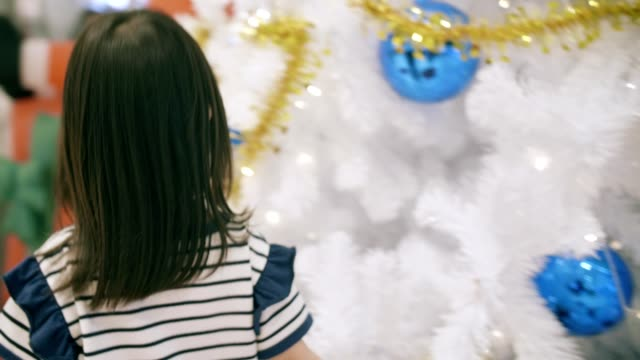 Portrait of cute little girl(4-5 years) excitement in christmas festival