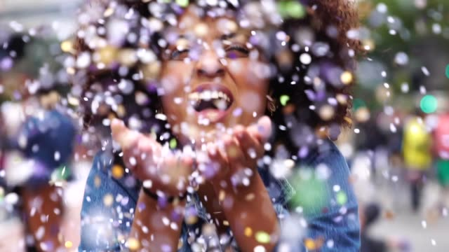 portrait of cute woman blowing confetti - excitement stock videos & royalty-free footage