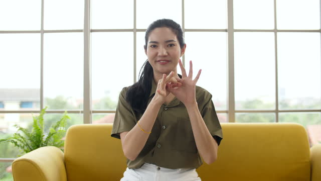 portrait of deaf woman using hand gestures for communication, conversation in sign language - careless stock videos & royalty-free footage