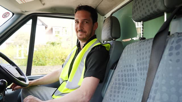 portrait of delivery driver in van - one mid adult man only stock videos & royalty-free footage